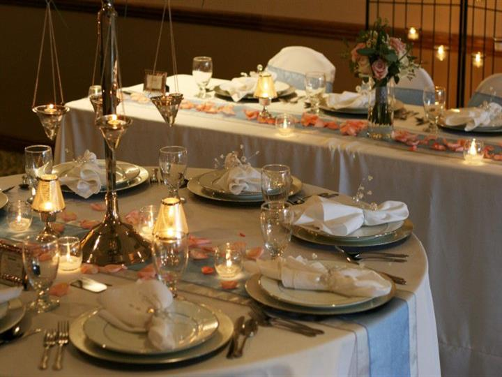 Set table with dining ware, candles, and flowers