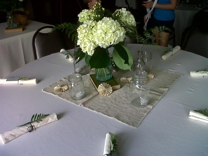 Set table with rolled napkins and flower decorations