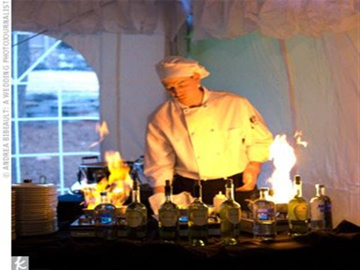Chef behind a stove with multiple alcoholic drinks