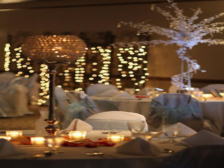 Set table with candles and uniformly set napkins