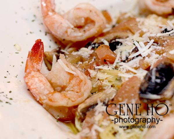 Shrimp with grated cheese in white bowl