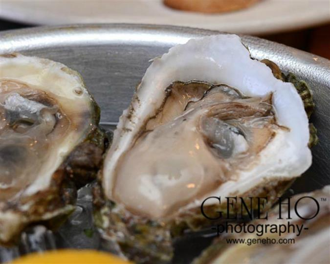 Oyster prepared on a silver platter