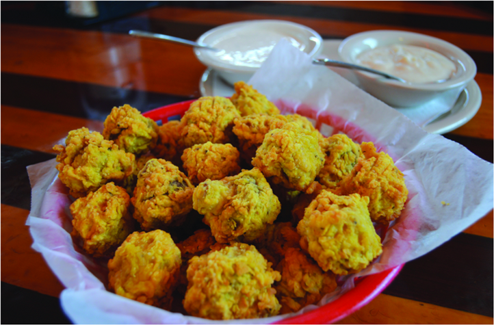 basket of fried cauliflower with dip;ping sauces