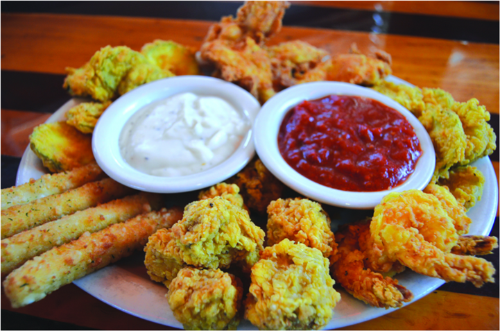 fried appetizer plate with dipping sauces