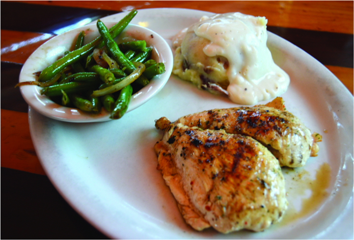 grilled chicken thigh with mashed potatoes and string beans
