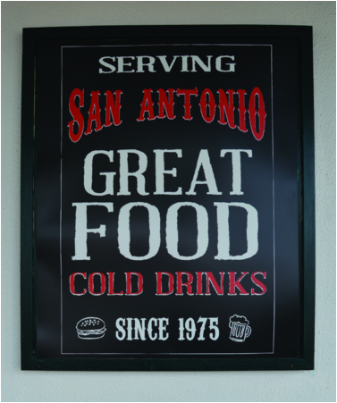 signage that says serving san antonio great food, cold drinks since 1975