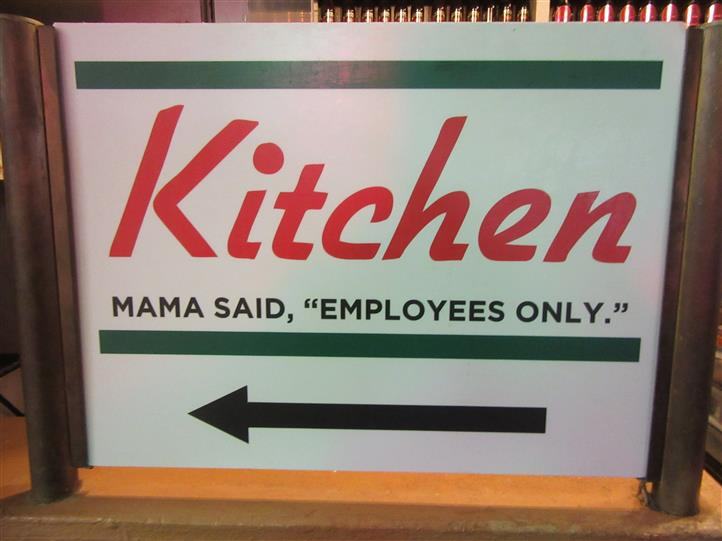 "signage pointing to the kitchen. mamas said ""employees only"""