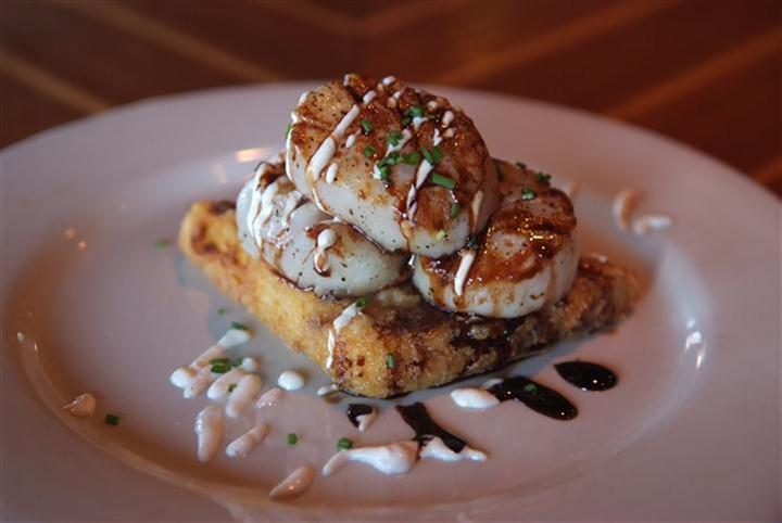 Scallops - Caramelized & served on a fried grit cake with a smoked chili cream & balsamic  glaze