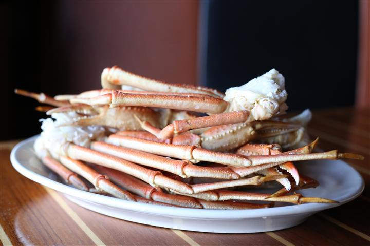 Crab Legs - Two & a half pounds of snow crab legs steamed & served with  drawn butter