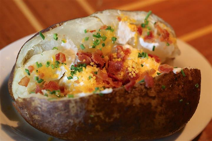 Loaded Baked Potato with chives, bacon, cheddar and sour cream.