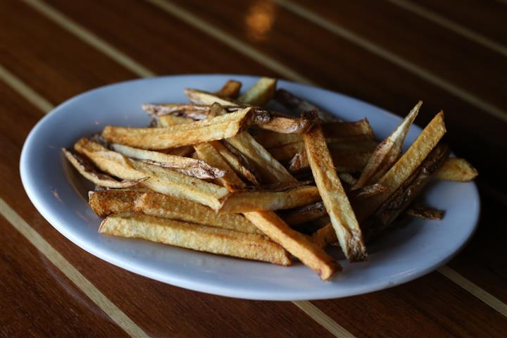 french fries on a white plate.