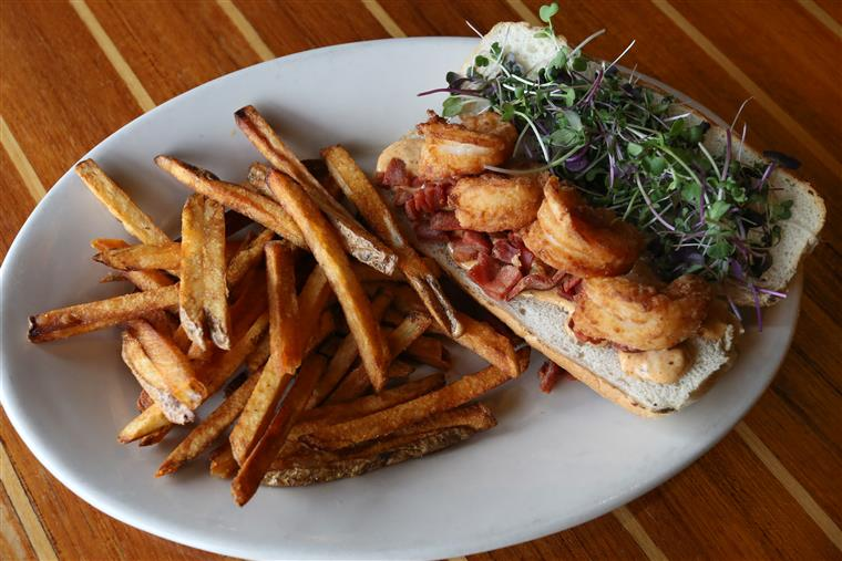 Po-Boy sandwich with a side of fries.