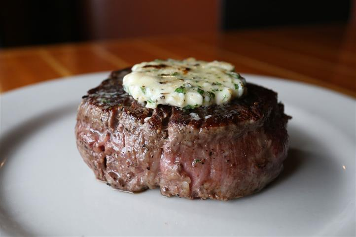 Filet Mignon - Aged 8oz Certified Angus Beef® charcoal grilled & topped with a housemade gorganzola compound butter