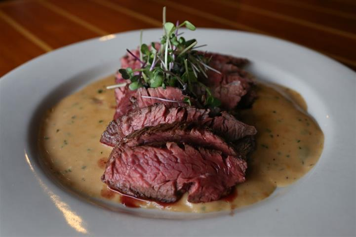 Hanger Steak - Aged 10oz Certified Angus Beef® pan seared & served over a smoked gouda cream sauce