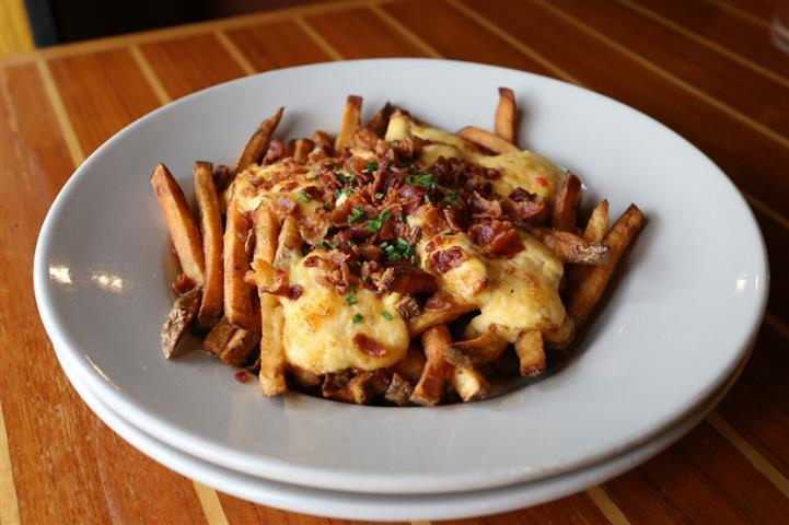 Pimento Cheese Fries - A twist on a southern classic using Grandma Smith's family recipe  topped with bacon & fresh chives