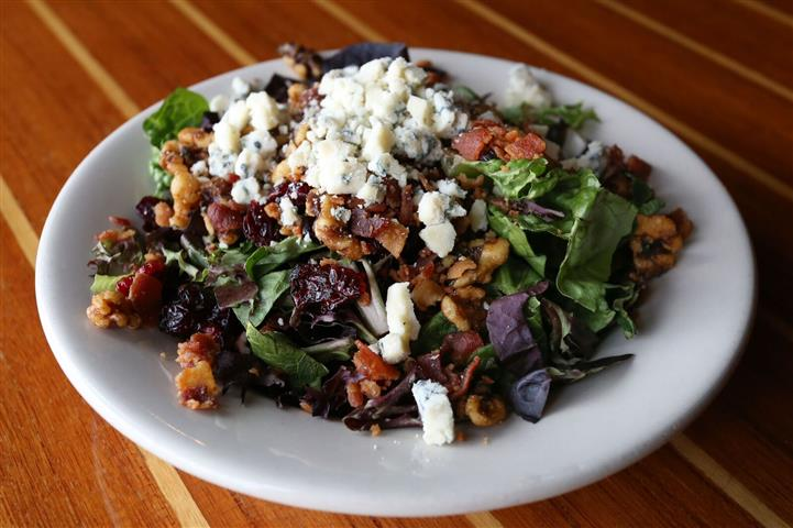 House salad - Artisan greens with gorganzola crumbles, bacon, dried cranberries & candied walnuts