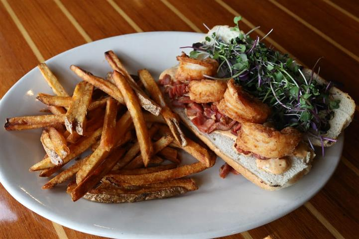 Po-Boy - Fried shrimp & country ham with our house-made Cajun tartar topped with fresh micro greens