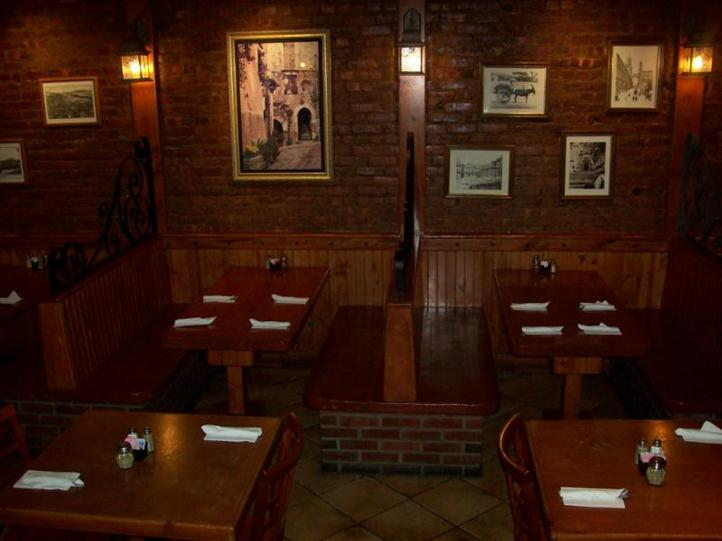 two booths with pictures hanging on the wall