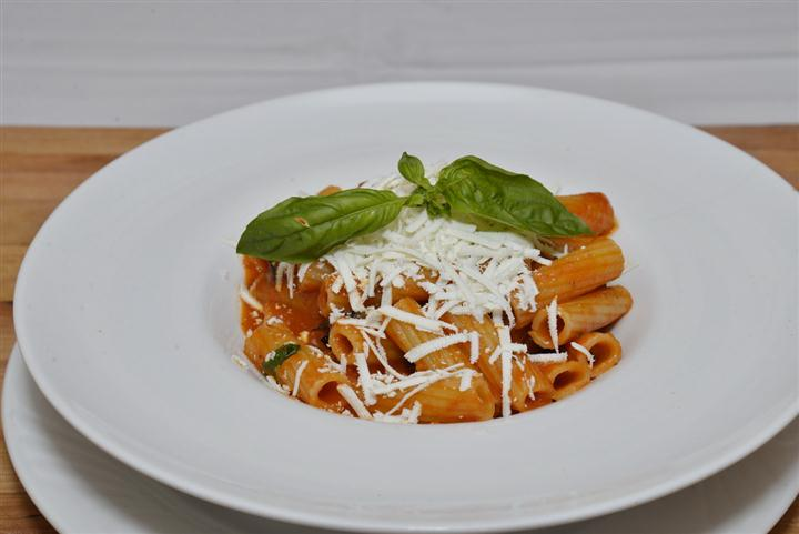 rigatoni pasta topped with cheese