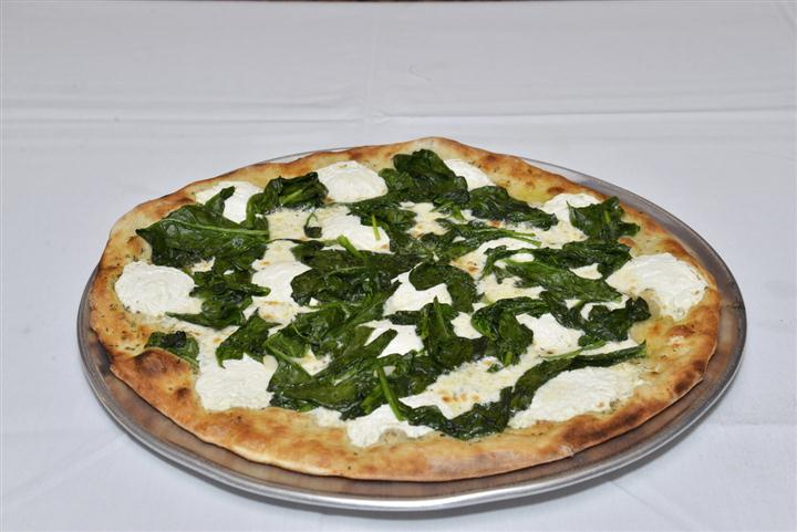 whole feta cheese pizza with spinach