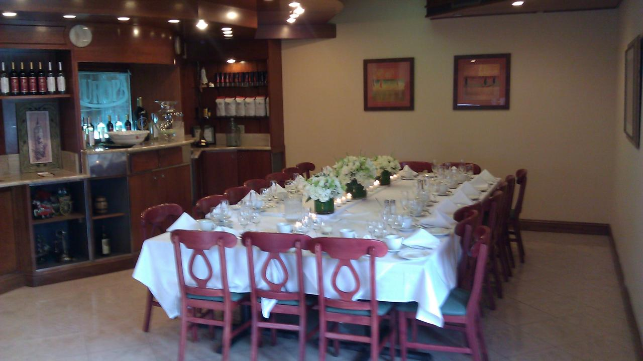 large table set with plates and silverware