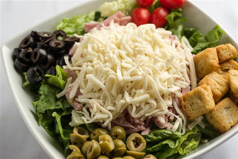 Rochetto's House Salad. Diced ham, tomatoes, eggs, green and black olives over an iceberg/romaine blend, topped with mozzarella cheese and seasoned croutons.