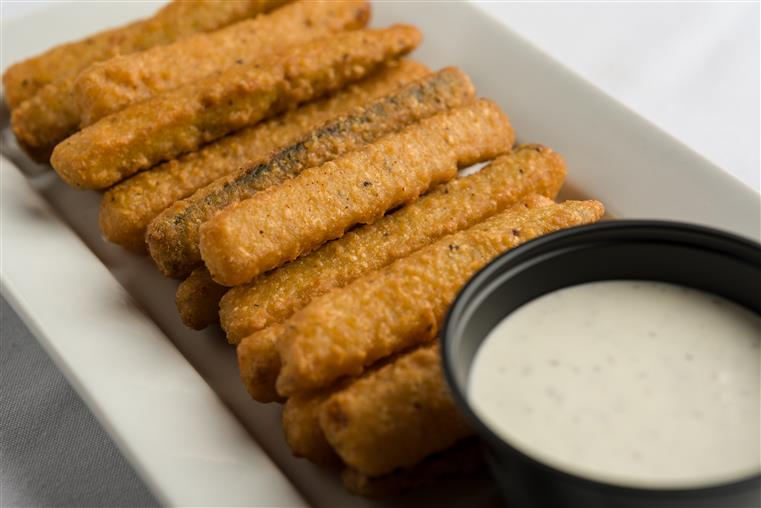 Fried zucchini sticks battered and served with house ranch dressing
