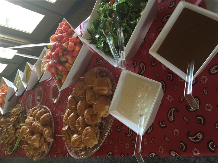 Catering buffet with salads, sauces, sandwiches