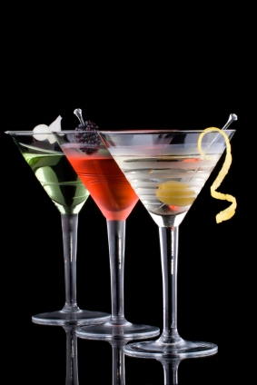 three martini glasses with different drinks in each one