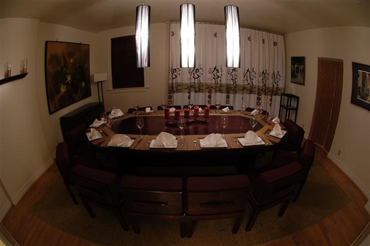oval table set for 14 epople