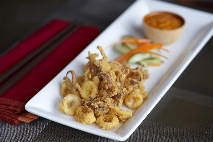 crispy calamary on a plate with chili aioli sip