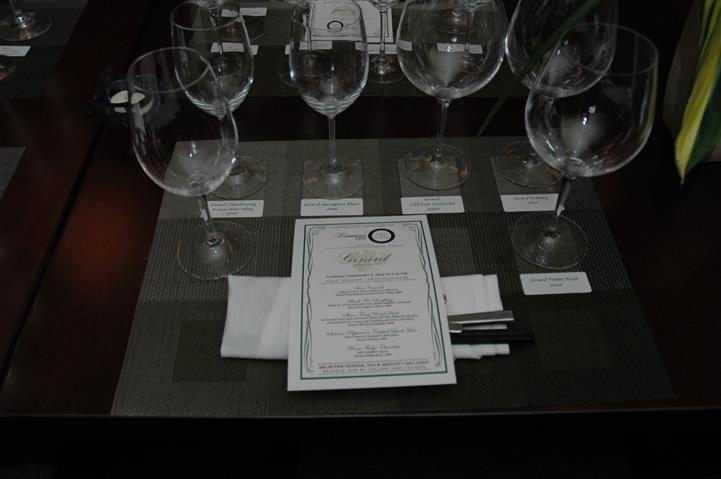 black and whtie photo of menu and 6 empty wine glasses