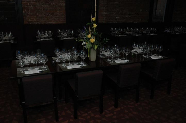 empty tables with empty wine glasses