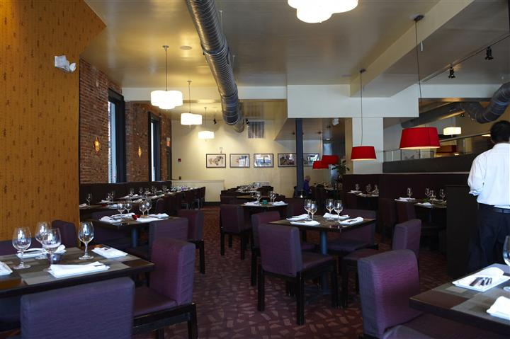 inside of restaurant with empty tables set