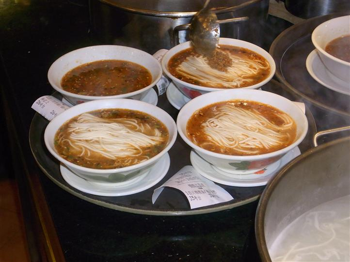 Tray with four different bowls of soup