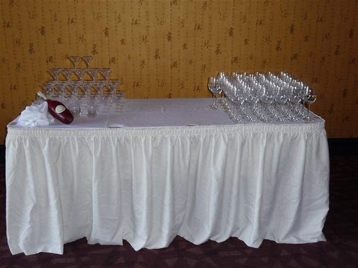 white table with empty martini glasses and empty wine glasses