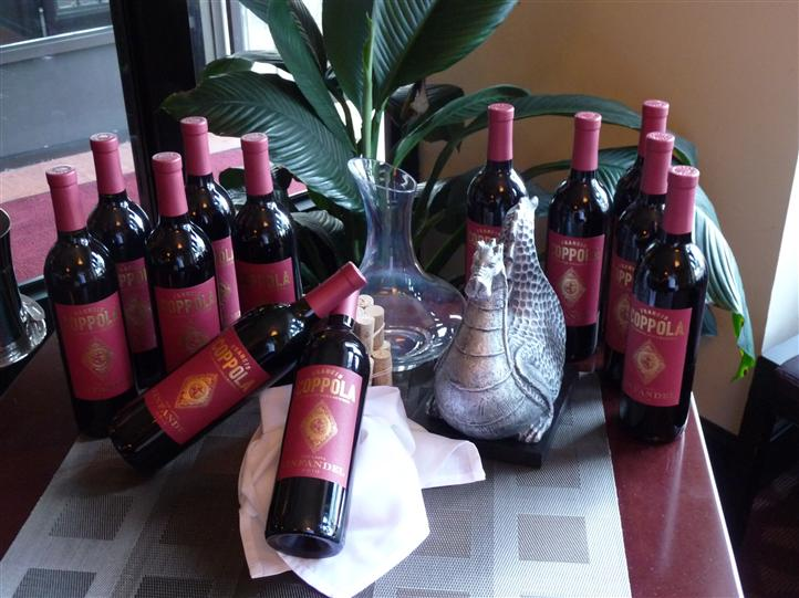 several bottles of wine unopened on a table