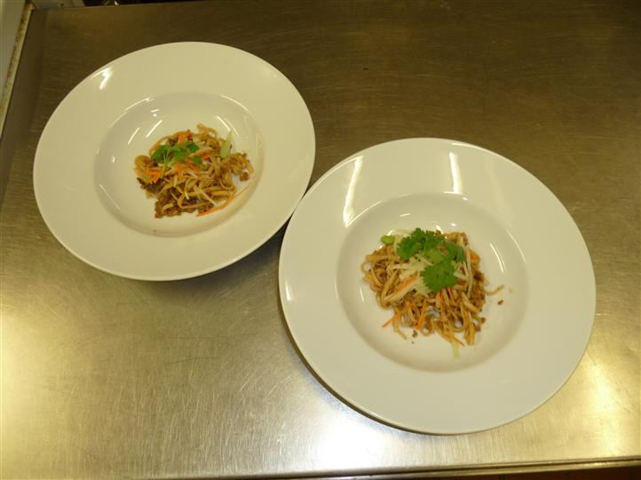 two white plates with food