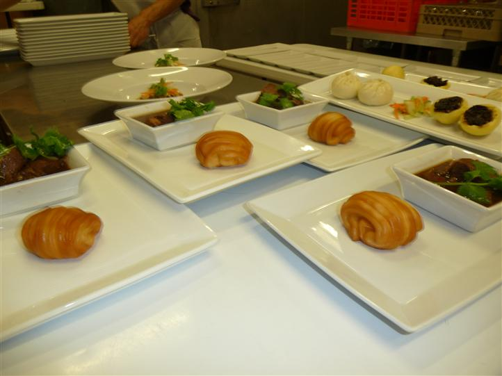 several white plates with menu items on them