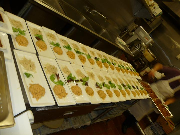 rows of white plates with the same menu item on it