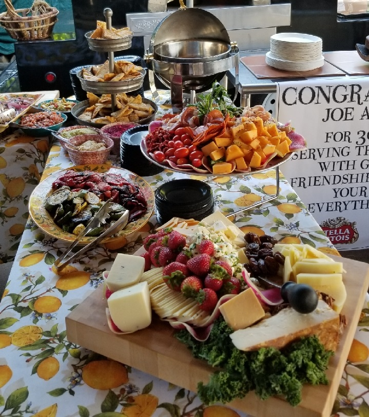 Photo of cheese, meats and fruit buffet