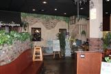 mural inside restaurantof water fountain and outside