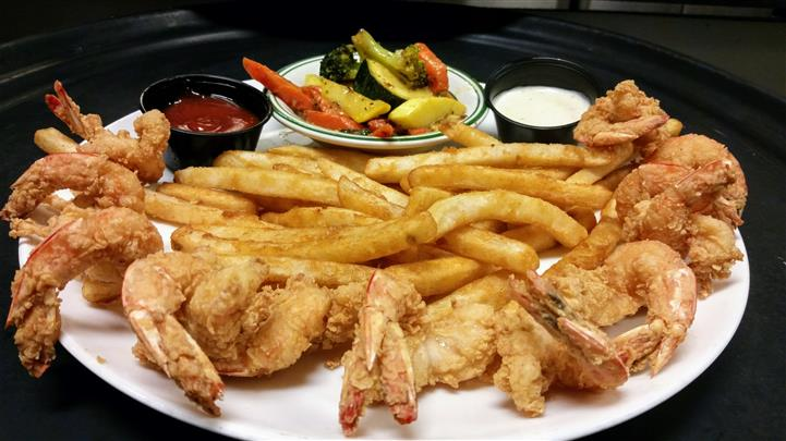 Fried shrimp, fries, side of ketchup and tartar sauce and a small bowl of mixed vegetables
