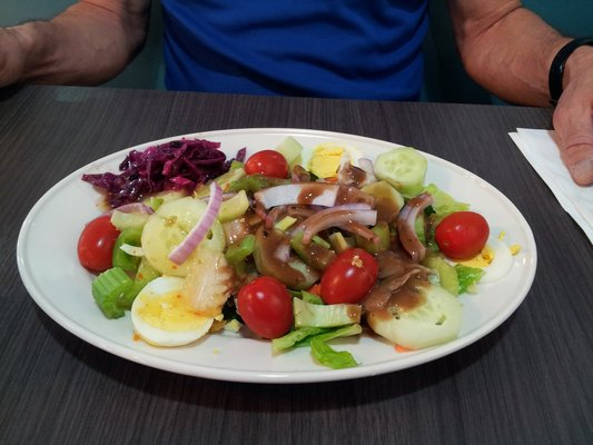salad with eggs, tomatoes, onions