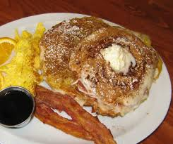 eggs, bacon, pancakes topped with butter