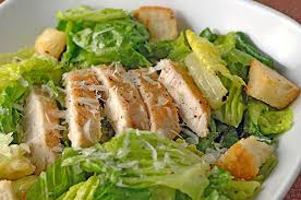 grilled chicken on a bed of lettuce