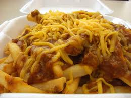 french fries topped with cheese and chil