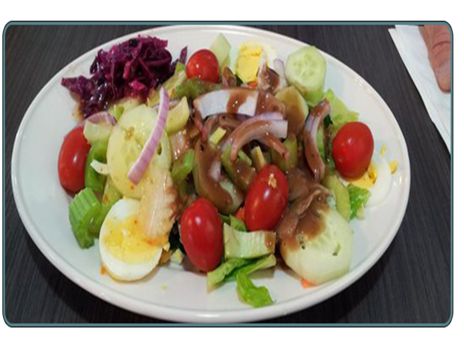 salad with tomatoes sliced onions and egg slices