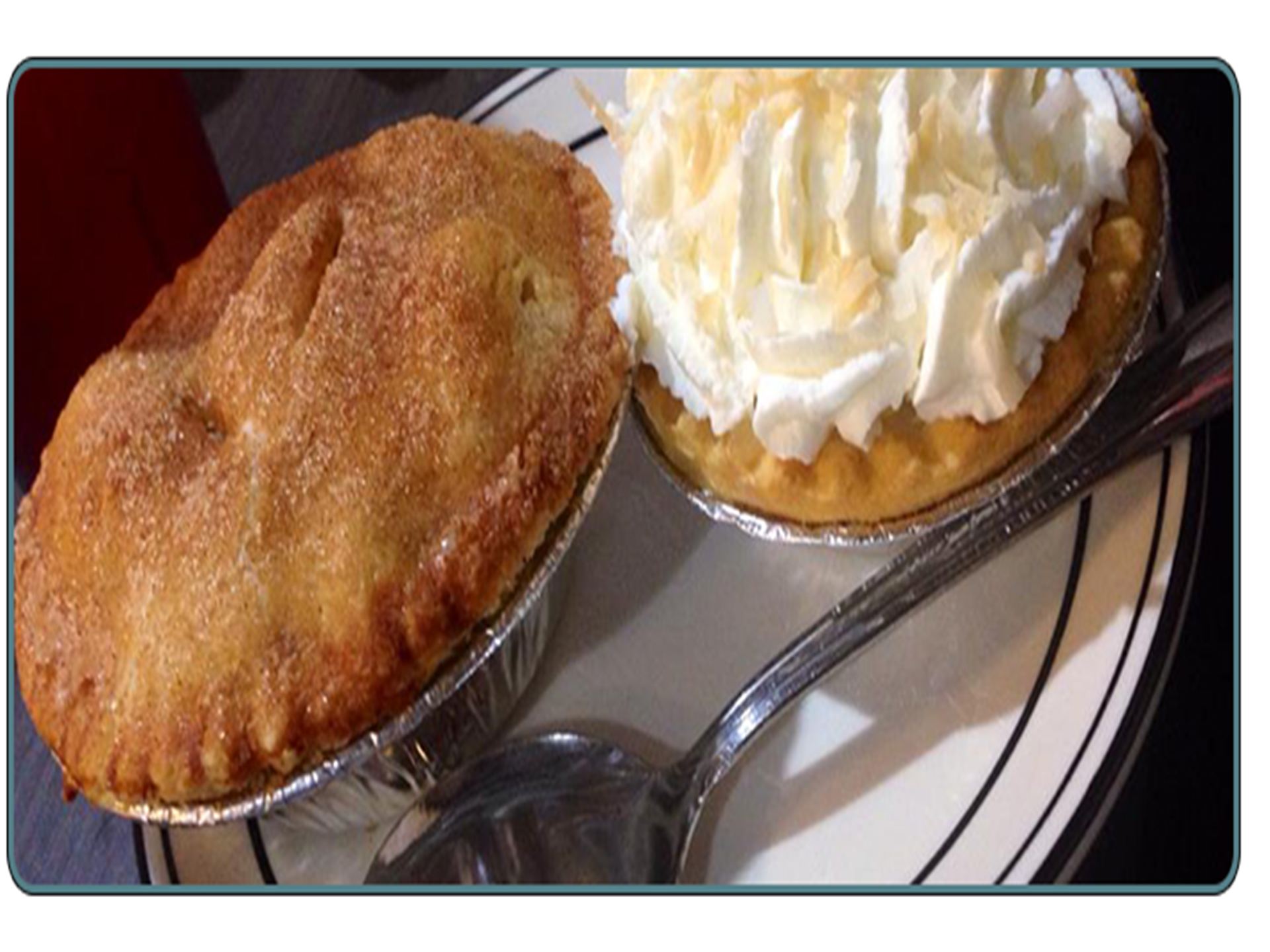 two small pies. one is topped with whipped cream
