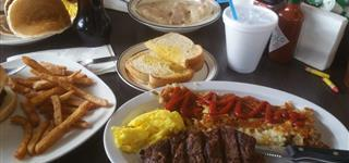 steak, hashbrowns, eggs and toast
